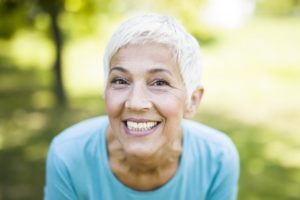 senior woman smiling proudly thanks to adult Invisalign in Portland